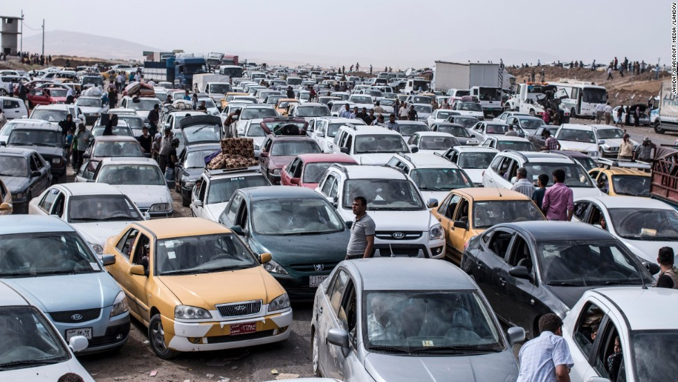 Vehicles clog a highway as refugees flee Mosul on Tuesday, June 10.