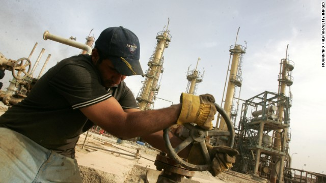 An Iraqi worker adjusts a control valve at the Daura oil refinery on November 5, 2009 in Baghdad, Iraq. Iraq and a grouping of U.S and European oil companies Exxon Mobil Corp and Royal Dutch Shell PLC signed a $50 billion contract today to develop the West Qurna oilfield, two days after the Iraqi South Oil Company signed a technical service contract with Britain's BP and China's CNPC to develop the Rumaila oilfield. The Iraqi government is trying to attract foreign investment, especially in the oil sector, in hopes of reviving its war-torn economy. Iraq has the third largest oil reserve in the world but it is producing way below its potential. (Photo by Muhannad Fala'ah/Getty Images)