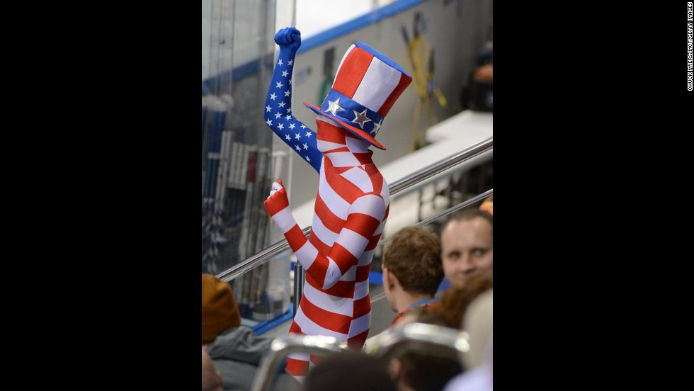 A fan dressed in an American flag bodysuit dances during the Olympic hockey game between the United States and the Czech Republic in February.