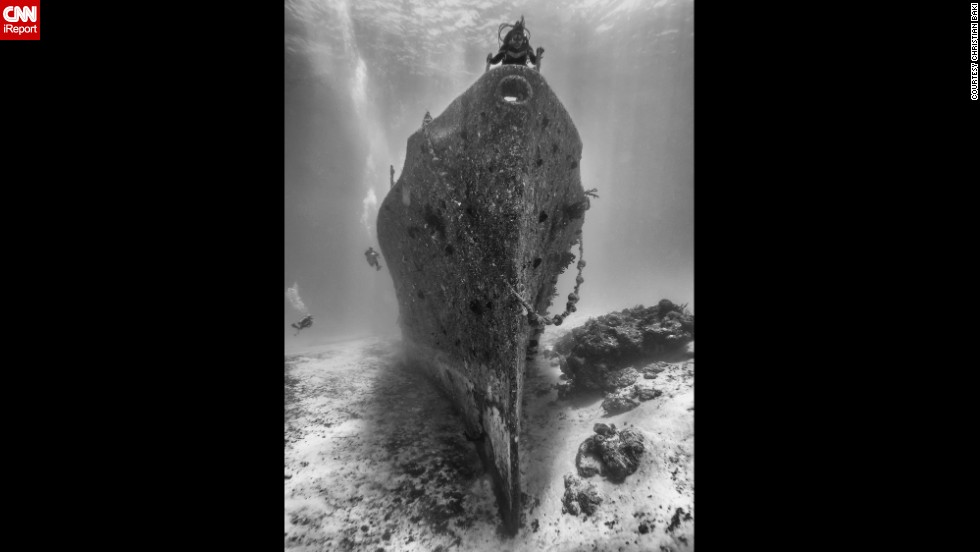 "<a href=""http://ireport.cnn.com/docs/DOC-1141527"">Christian Baki's </a>wife claims her spot on top of the Felipe Xicotencatl shipwreck during a dive in Cozumel, Mexico."