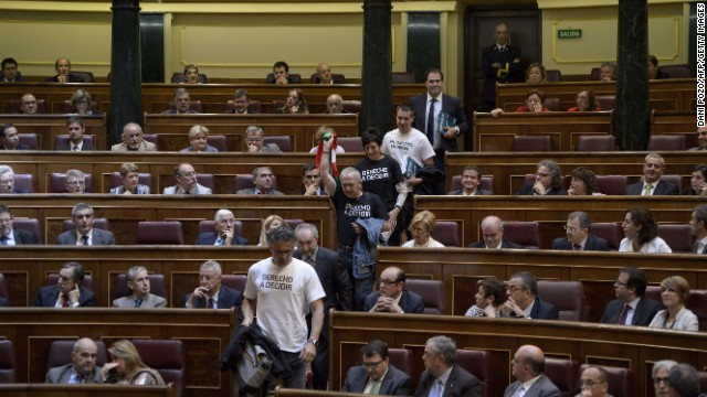 Spanish left-wing Basque nationalist and separatist political coalition AMAIUR members leave in protest moments before polls in Spain's lower house of parliament on June 11, 2014 during a session to vote on the bill allowing the abdication of King Juan Carlos with the senate following suite on June 17. Both the ruling Popular Party and opposition Socialists back Felipe's succession, Spanish lawmakers are then expected to swear in the 46-year-old future King Felipe VI at a ceremony -- to which no foreign dignitaries have been invited -- on June 19, although the date has not yet been finalised.