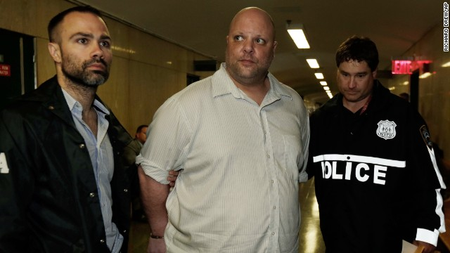 Carmine Vitolo, center, a manager at RoadHouse NYC Gentlemen's Club, pleaded not guilty to charges of conspiracy, grand larceny and tampering with evidence.