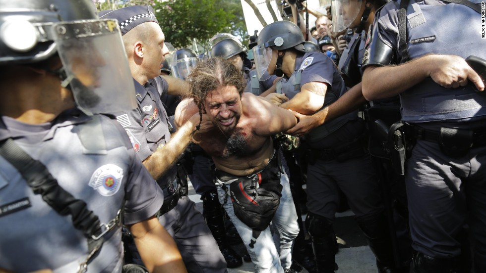 Another protester is detained by police June 12 in Sao Paulo.