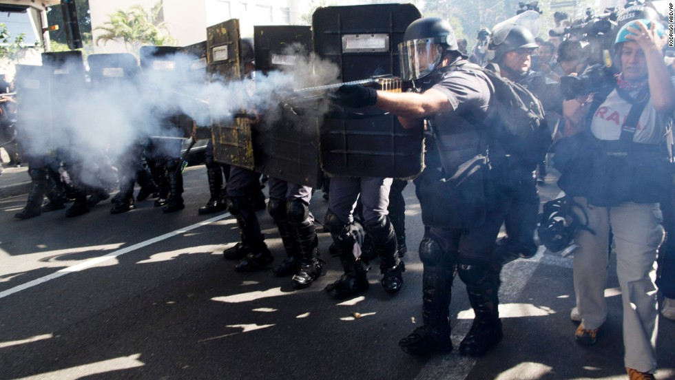 Police fire rubber bullets at protesters in Sao Paulo.