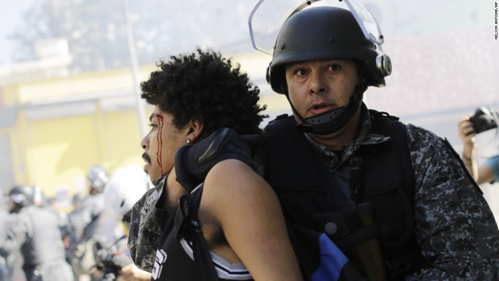 A protester is detained by police on June 12, the opening day of the World Cup. Protesters in Sao Paulo were trying to block part of the main highway that leads to the stadium hosting the first match.