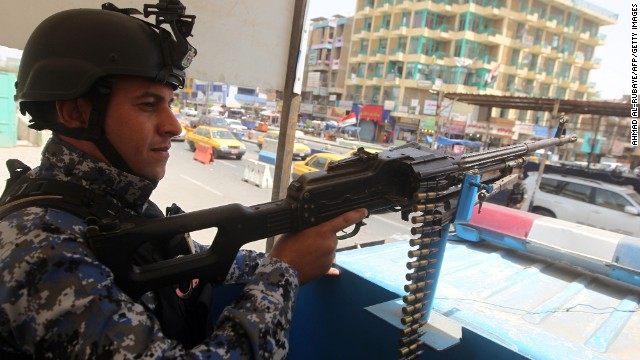 An Iraqi policeman mans a checkpoint in the capital Baghdad on June 12, 2014, as jihadists and anti-government fighters have spearheaded a major offensive that overrun all of Nineveh province.