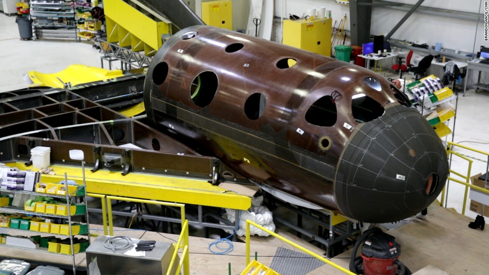 It's called SpaceShipTwo, Series Two. Workers assemble one of the newest Virgin Galactic spacecraft, which is expected to fly tourist passengers about 60 miles high to sub-orbital space sometime in 2015.