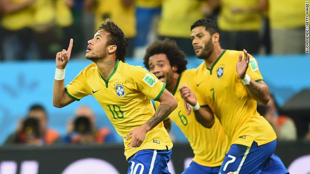 Neymar of Brazil celebrates scoring a first half goal with Marcelo and Hulk during the 2014 FIFA World Cup Brazil Group A match between Brazil and Croatia at Arena de Sao Paulo on June 12, 2014 in Sao Paulo, Brazil. (Photo by Buda Mendes/Getty Images