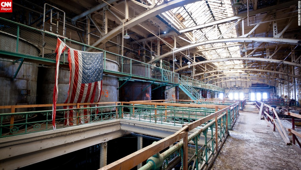 "A tattered American flag hangs over the now demolished Schlitz Brewery in Milwaukee, Wisconsin. Urban explorer <a href=""http://ireport.cnn.com/docs/DOC-1075888"">Ken Fager</a> took this photo while visiting the derelict building in March 2012."