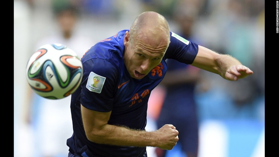 Robben heads the ball in the first half.