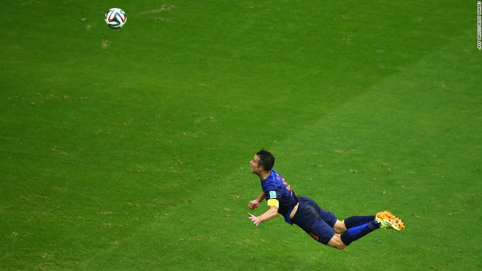 Van Persie scores a diving header in the first half of the match against Spain. It tied the score at 1-1.