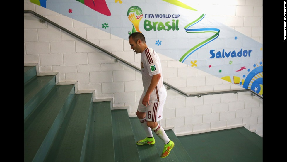 Spanish midfielder Andres Iniesta walks to the dressing room after the game against the Netherlands in Salvador, Brazil.