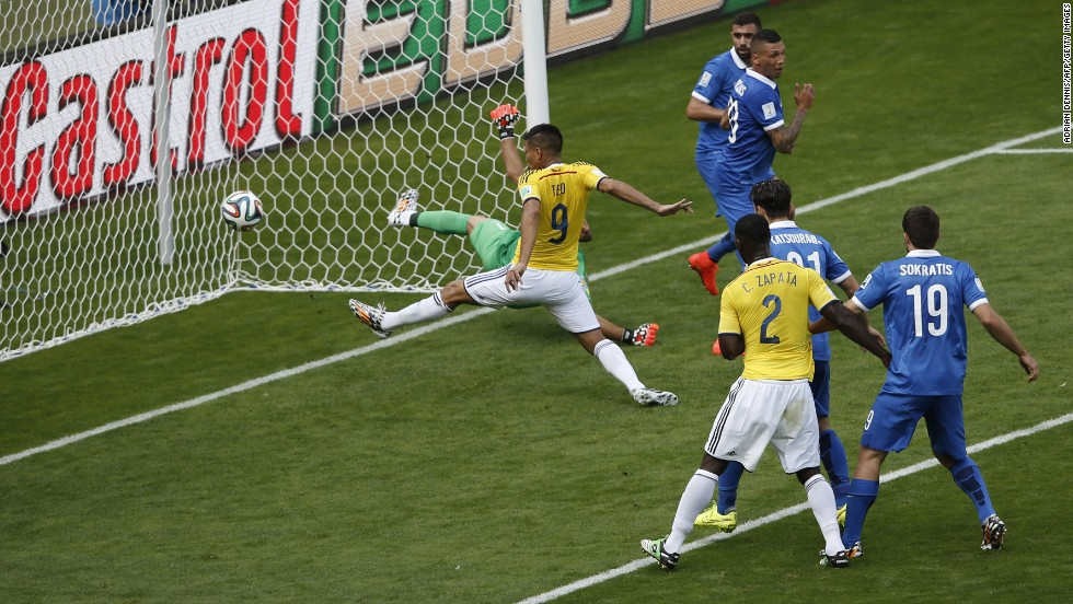 Colombia forward Teofilo Gutierrez scores the second goal.