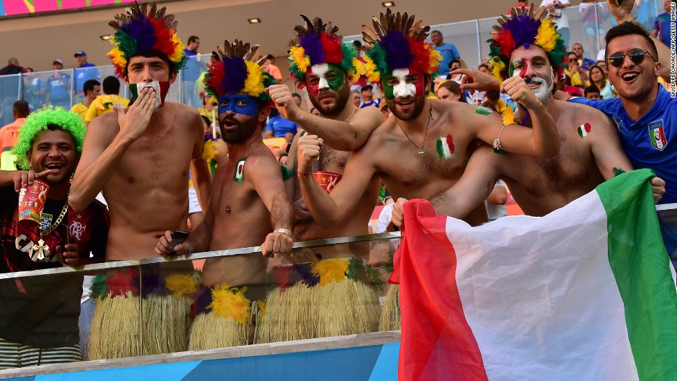 Italy fans cheer as they wait for the kickoff of the World Cup match against England.