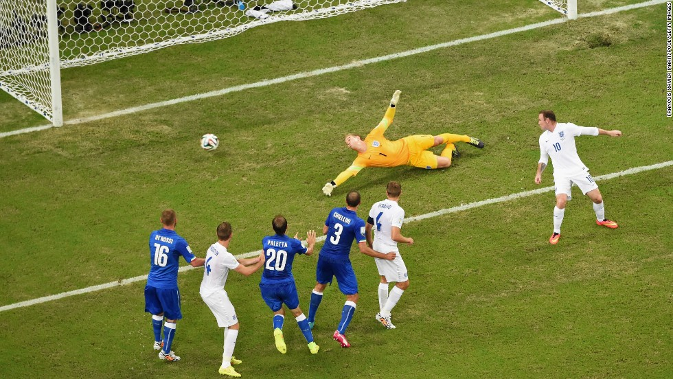 England goalkeeper Joe Hart dives as Claudio Marchisio's long-range shot gives Italy the lead.