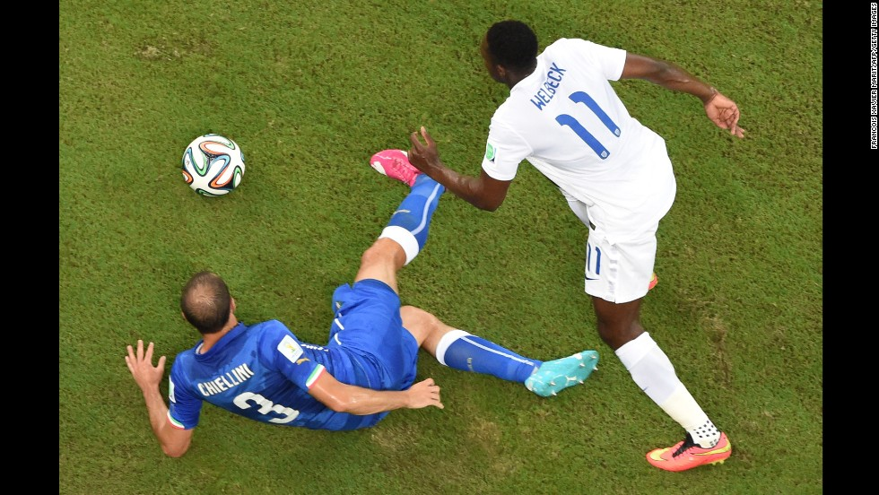 Italy's defender Giorgio Chiellini, left, and England's forward Daniel Welbeck vie for the ball.