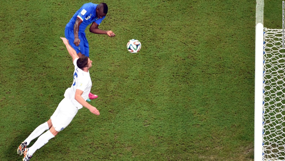 Italy striker Mario Balotelli, left, heads the winning goal against England on June 14. Italy defeated England 2-1 in Manaus, Brazil.