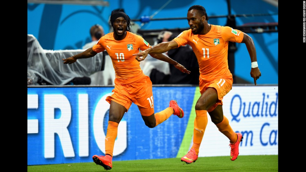 Gervinho, left, celebrates with Didier Drogba of the Ivory Coast after scoring the team's second goal in their World Cup match against Japan on Saturday, June 14. Ivory Coast trailed 1-0 at halftime but came back to win 2-1 in Recife, Brazil.