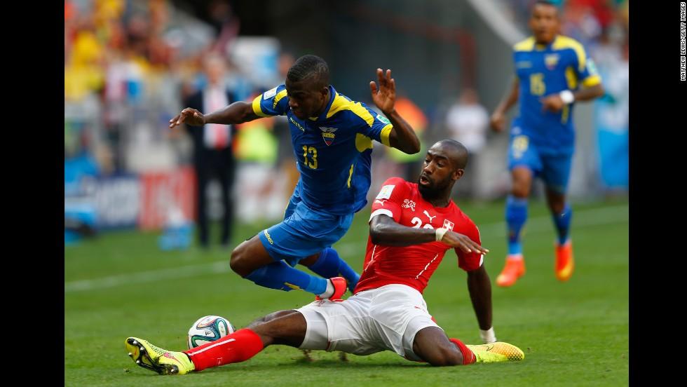 Johan Djourou of Switzerland tackles Enner Valencia of Ecuador