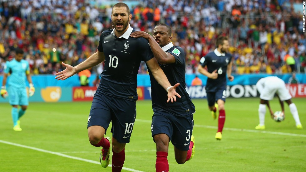 Benzema celebrates with Patrice Evra after scoring France's first goal against Honduras.