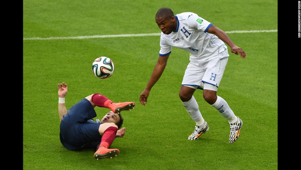 France midfielder Mathieu Valbuena hits the ground while battling for the ball with Honduras' Wilson Palacios.