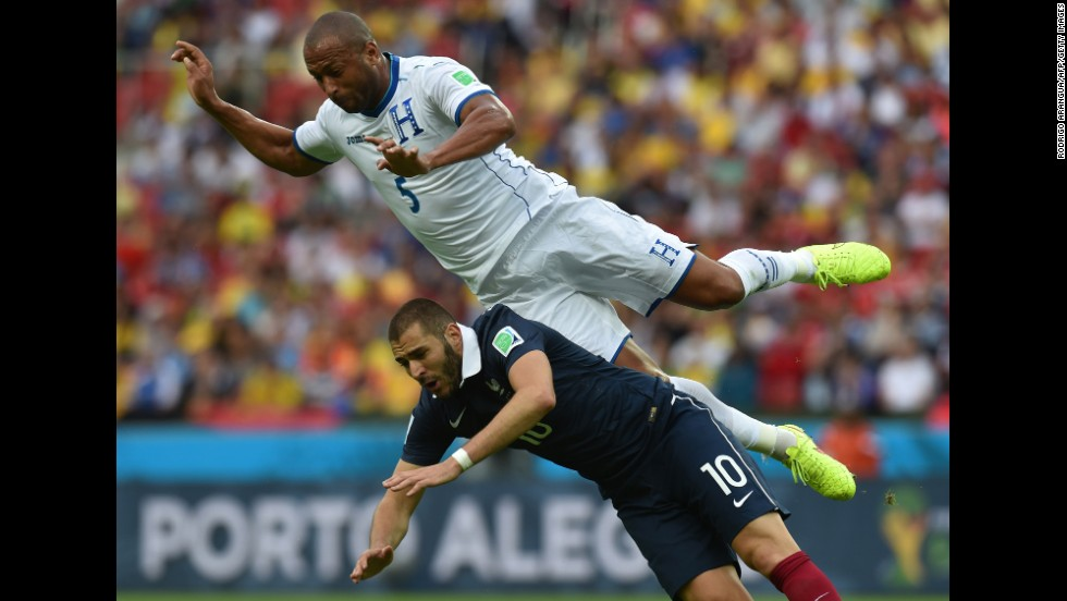 Honduras defender Victor Bernardez falls over France forward Karim Benzema.