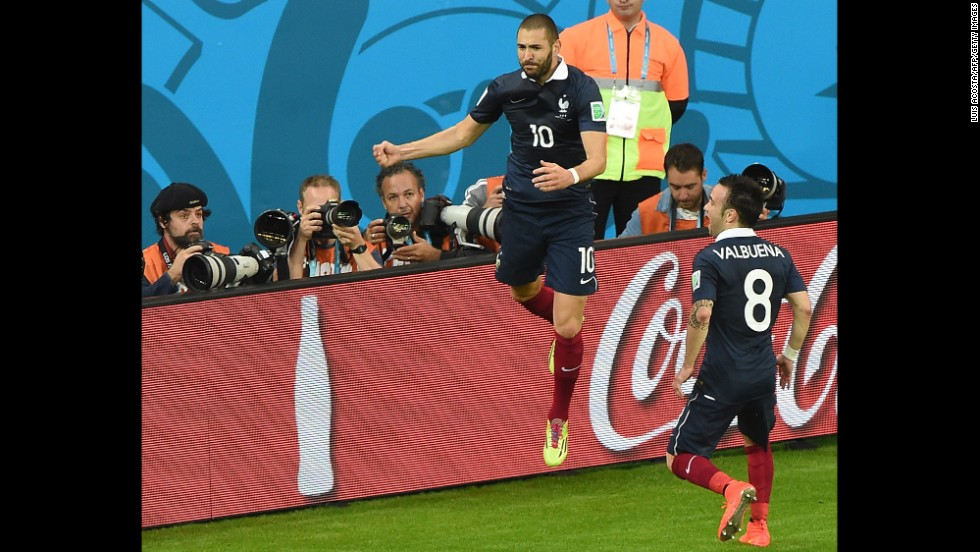 France forward Karim Benzema celebrates after scoring his team's third goal.
