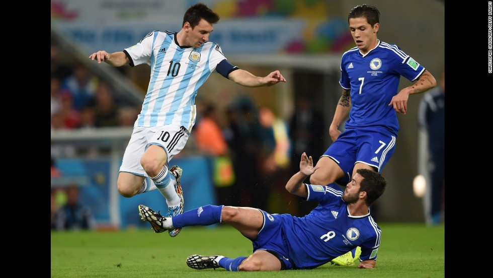 Argentina forward and captain Lionel Messi fights for the ball with Bosnia-Herzegovina defender Muhamed Besic and midfielder Miralem Pjanic.