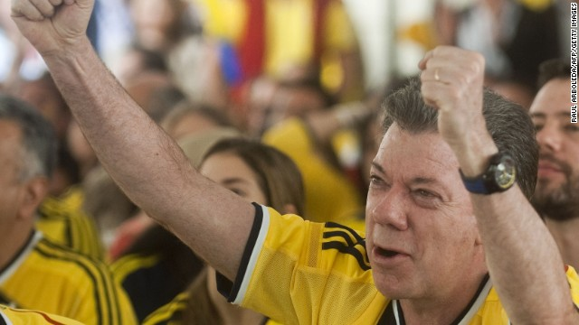 Colombia's re-elected president Juan Manuel Santos celevrates while watching a World Cup match between Colombia and Greece.