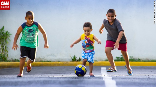 misael photographed his children playing soccer outside their home in Santo Domingo, Dominican Republic, on June 14. 'My kids love baseball, but for a days here they have replaced the bat and glove for a football,' he said.