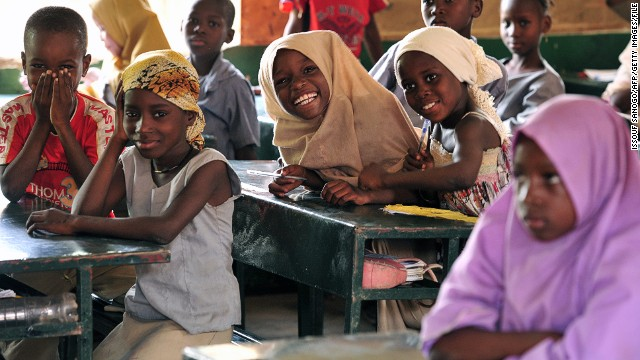 Children pose in a classroom at the Friendship Primary school in Zinder on June 1, 2012. Some 238 schools in the Zinder region benfit from a school cantine program run by the 'Programme alimentaire mondial (PAM)' that feed around 43841 children of which 2917 girls.
