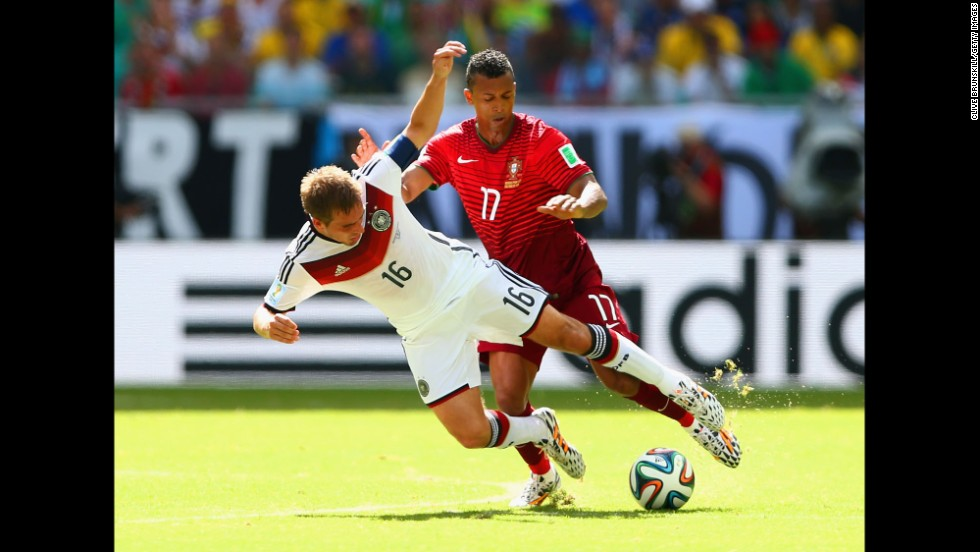 Germany's Philipp Lahm, left, competes for the ball with Portugal's Nani.