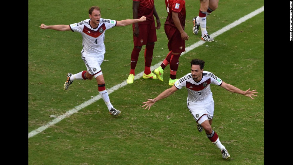Mats Hummels, right, celebrates after heading in a corner kick to put Germany up 2-0.