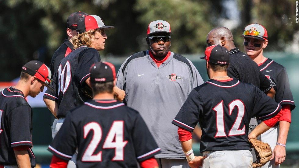 After retiring from baseball, Gwynn became head coach of the baseball team at his alma mater, San Diego State University. Here, he talks to the team during an NCAA tournament game in 2013.