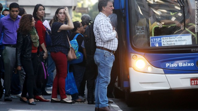 People wait on line to board a crowded bus during a tangled morning commute on June 9, 2014 in Sao Paulo, Brazil. Metro workers have entered their fifth day of a strike in the city leaving most metro stations closed and causing major traffic jams. (Photo by Mario Tama/Getty Images)