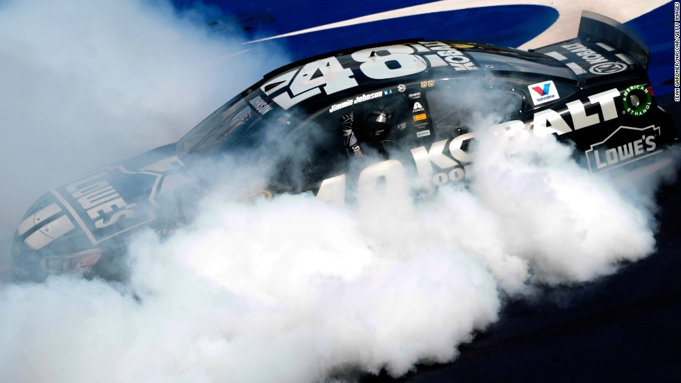 Jimmie Johnson celebrates with a burnout after winning the NASCAR Sprint Cup race at Michigan International Speedway on Sunday, June 15. It was Johnson's first career win at the venue.