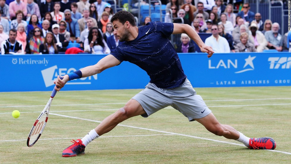 Grigor Dimitrov reaches for a shot Sunday, June 15, in the final of the Aegon Championships in London. Dimitrov defeated Feliciano Lopez in three sets.