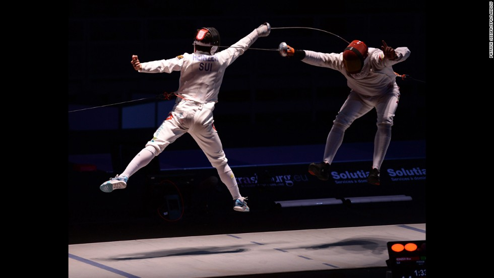 Max Heinzer of Switzerland, left, competes against Jose Louis Abajo of Spain in the men's epee team final at the European Fencing Championships in Strasbourg, France, on Wednesday, June 11. Switzerland won the event.