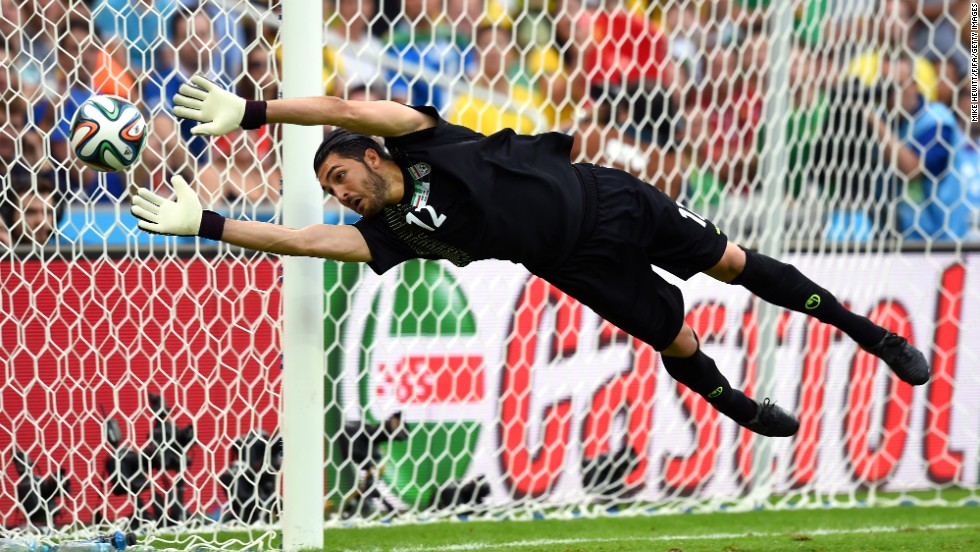 Iranian goalkeeper Alireza Haghighi makes a save against Nigeria. The match ended 0-0 and was the first draw of the tournament.