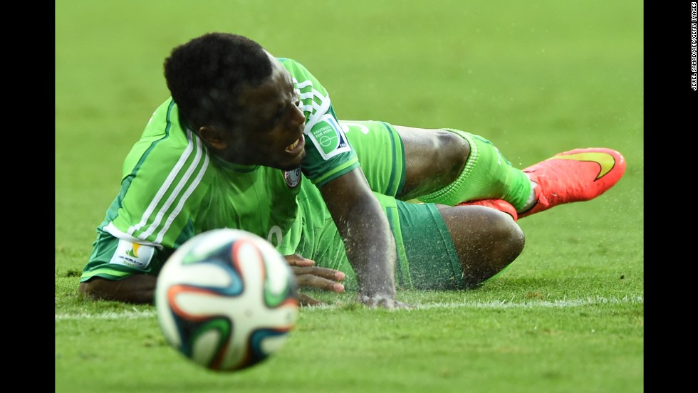 Nigerian forward Emmanuel Emenike takes a fall.