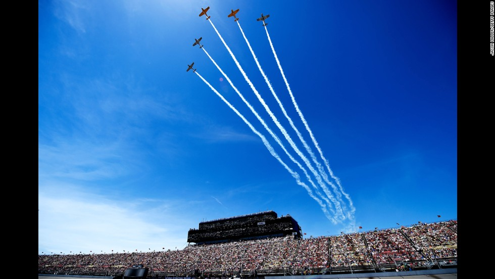 Five airplanes fly over Michigan International Speedway prior to a NASCAR Sprint Cup race Sunday, June 15, in Brooklyn, Michigan.