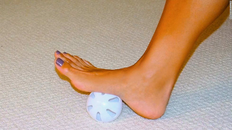 To massage the arches of the foot, sit in a chair or on the edge of a bed, place the ball under your foot (starting in the arch) and slowly roll your foot back and forth for about two minutes. The massage motion should increase blood flow and help release tightness.