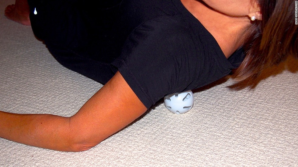 Lay on the floor with the ball under your shoulder blade. Slowly rock yourself back and forth over the ball, moving it around the large muscles encasing the blade.