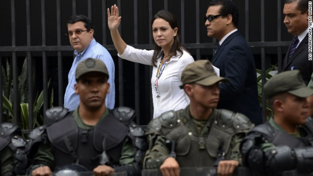Venezuelan opposition leader Maria Corina Machado waves upon arriving at Prosecutor's office in Caracas on June 16, 2014 to declare about her presumed involvement in an alleged plot to assassinate President Nicolas Maduro.