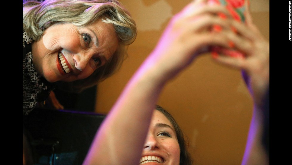 "Former U.S. Secretary of State Hillary Clinton poses for a photo with a young supporter at George Washington University on Friday, June 13, in Washington. Clinton was at the school discussing her new book, ""Hard Choices: A Memoir."""