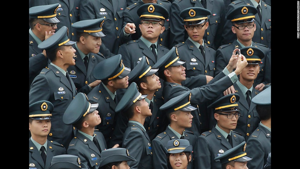 Military Academy graduates in Kaohsiung, Taiwan, take a selfie together before having a group photo taken during commencement ceremonies on Monday, June 16.