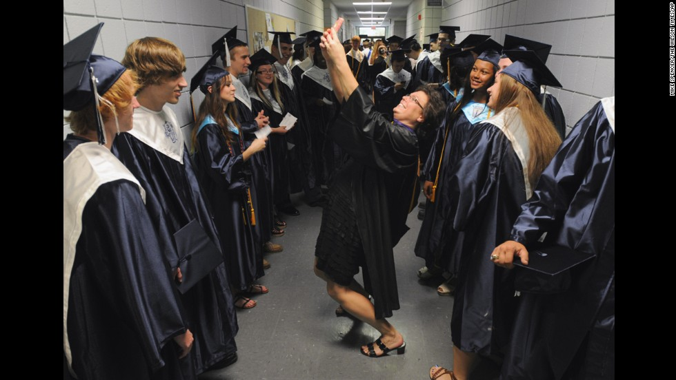 Teacher Cathy Johnson pauses to take a selfie with graduates of South Brunswick High School on Saturday, June 14, in Bolivia, North Carolina.