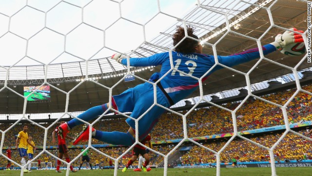 FORTALEZA, BRAZIL - JUNE 17: Guillermo Ochoa of Mexico dives to make a save during the 2014 FIFA World Cup Brazil Group A match between Brazil and Mexico at Castelao on June 17, 2014 in Fortaleza, Brazil.  (Photo by Robert Cianflone/Getty Images)