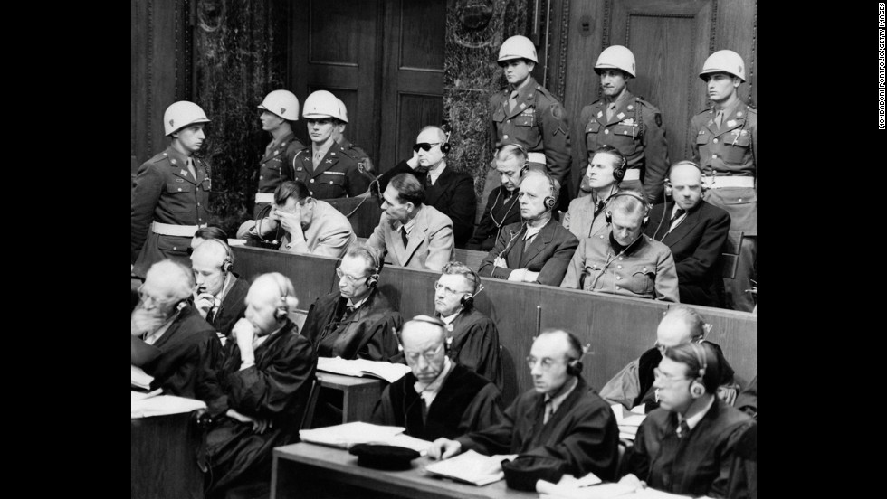 Versailles' collective punishment of a humiliated Germany is widely believed to have led to World War II, prompting a reorientation in international law: Guilty nations have been replaced by war criminals, prosecuted and punished by international tribunals.  Here, German war crimes defendants sit in the Nuremberg  courtroom of the International Tribunal after WWII. Hermann Goering, Rudolph Hess, Joachim Von Ribbentrop, Wilhelm Keitel (front row), and Karl Doenitz, Erich Raeder, Baldor von Schirach, Fritz Sauchel (second row).