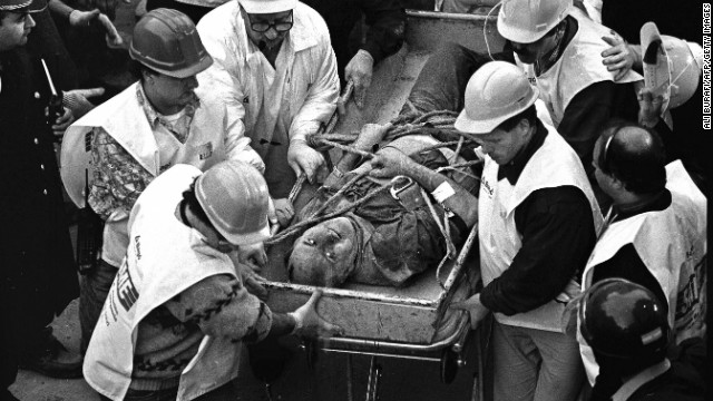 Argentine rescue workers evacuate Jacobo Chemanuel (56) found under the rubble after 36 hours of the blast wich destroyed Argentinian Israelite Mutual Association (AMIA) in Buenos Aires, killing 85 people 18 July 1994. Next18 July commemorates the 10th anniversary of the attack. The Argentine Justice until today has been unable to discover who was behind the bombing. Chemanuel died few months later due to his injuries.